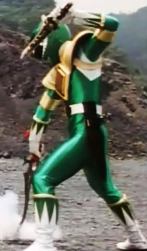 Green Ranger (Tommy Oliver) of the Mighty Morphin' Power Rangers dual-wielding daggers