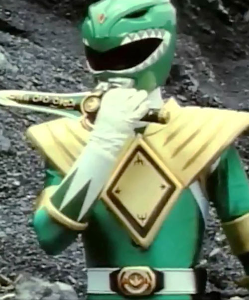 Green Ranger (Tommy Oliver) of the Mighty Morphin' Power Rangers dagger near lips