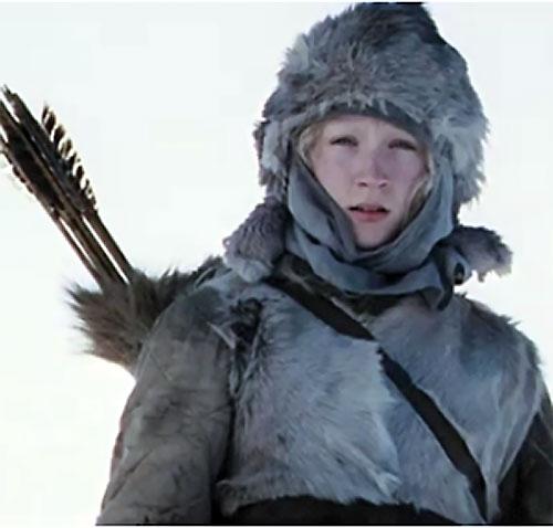 Hanna (Saoirse Ronan) with arrows and fur winter gear