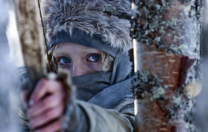 Hanna (Saoirse Ronan) aims her bow in a cold forest