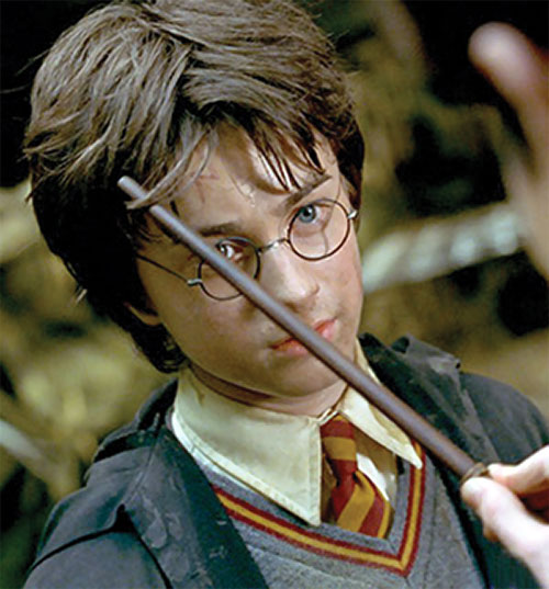 Harry Potter (Daniel Radcliffe in HP and the Chamber of Secrets) looking scruffy and with a wand on his brow