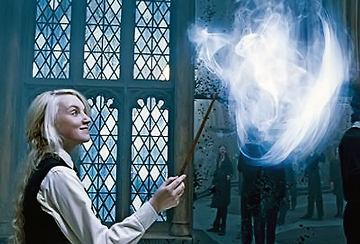 Luna Lovegood (Evanna Lynch) practices a spell