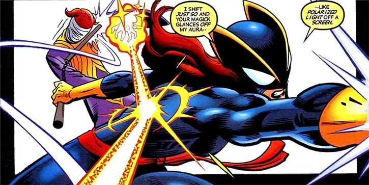 Hellcat (Patsy Walker) deflects a magical bolt