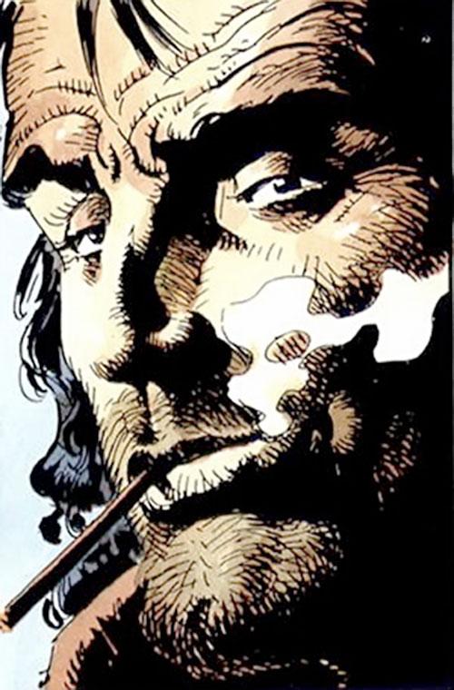 Hombre (Segura & Ortiz) smoking face closeup with big chin