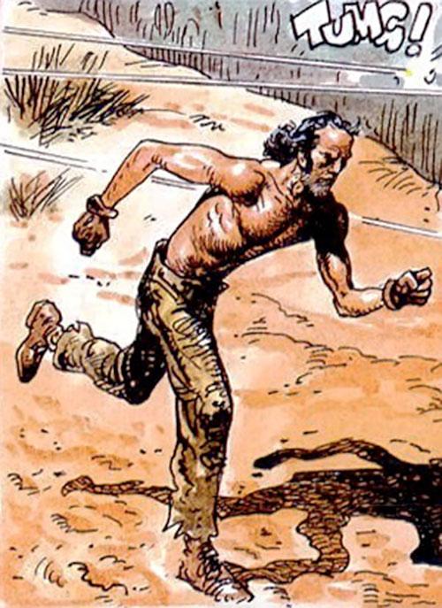 Hombre (Segura & Ortiz) running bare-chested under fire