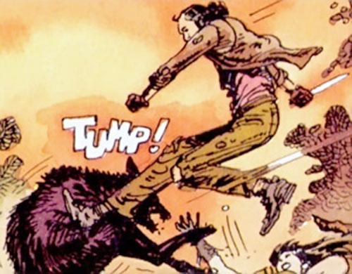 Hombre (Segura & Ortiz) jump-kicking a dog