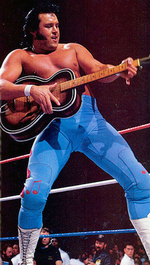 Honky-Tonk Man (wrestler) playing guitar in the ring