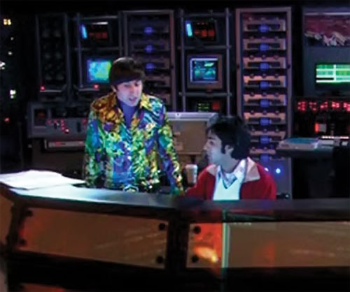 Howard Wolowitz (Simon Helberg in Big Bang Theory) with Raj at a control center