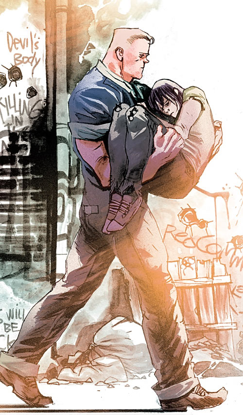 Huck (Image Comics) (Mark Millar) carrying a hurt young man