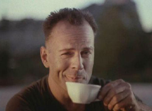 Bruce Willis as Hudson Hawk, having a coffee