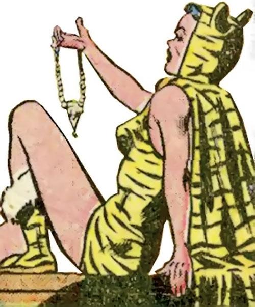 Huntress (Wildcat enemy) (DC Comics Golden Age) admiring a pendant