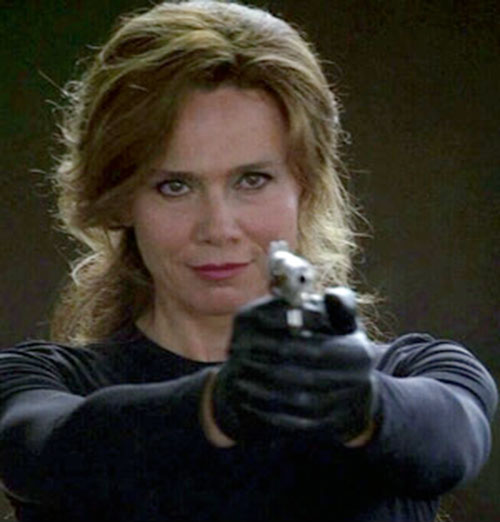 Irina Derevko (Lena Olin in Alias) smiling and aiming a pistol