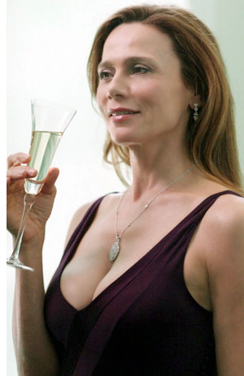 Irina Derevko (Lena Olin in Alias) in a cocktail dress and with a glass