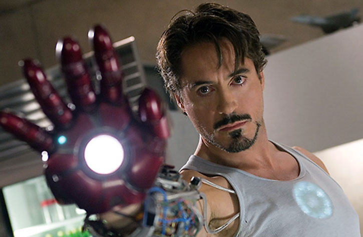 Tony Stark (Robert Downey Jr.) tests a palm repulsor
