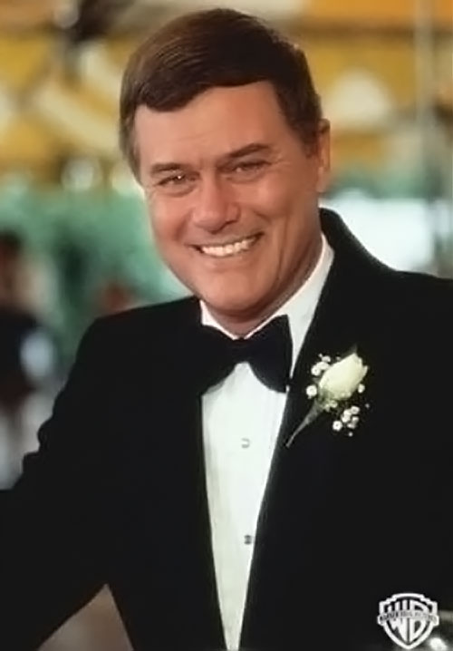 JR John Ross Ewing (Larry Hagman in Dallas) in a tuxedo with a white pinned flower
