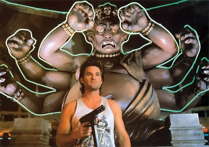 Jack Burton (Kurt Russell) in front of a demon statue with his gun