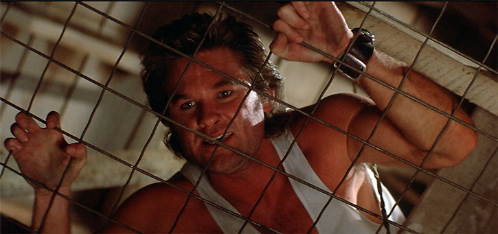 Jack Burton (Kurt Russell) behind chain links
