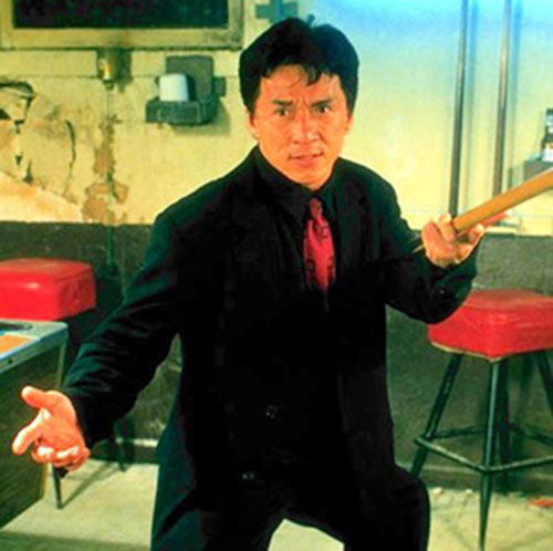 Jackie Chan in Rush Hour, fighting with a pool cue
