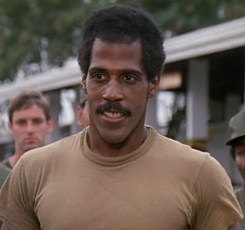 Jackson (Steve James in American Ninja) in a grey-green T-shirt