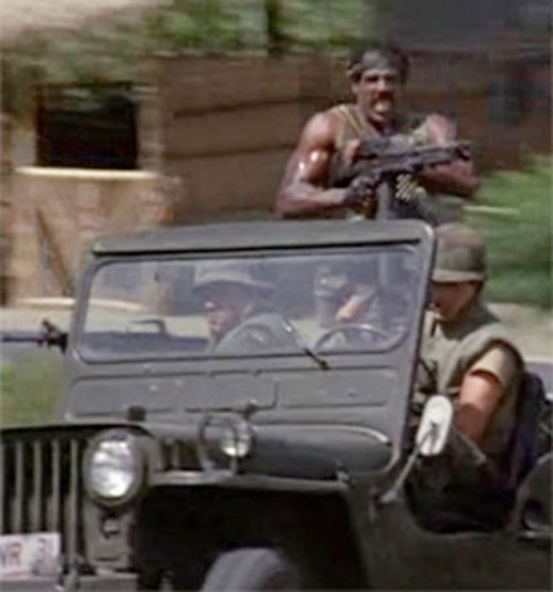 Jackson (Steve James in American Ninja) manning a M60 machinegun in a Jeep