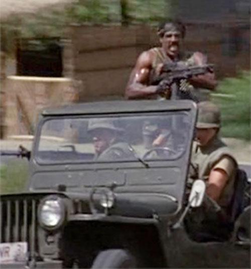 Jackson (Steve James in American Ninja) manning a M60 machinegun in a Jeep