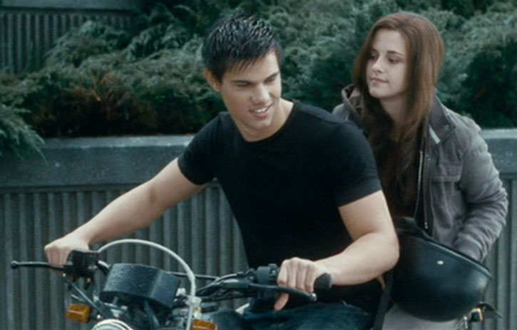 Jacob Black (Taylor Lautner) and Bella on a bike