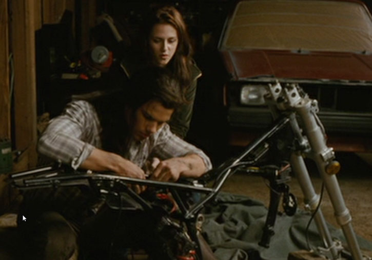 Jacob Black (Taylor Lautner) working on a motorbike chassis