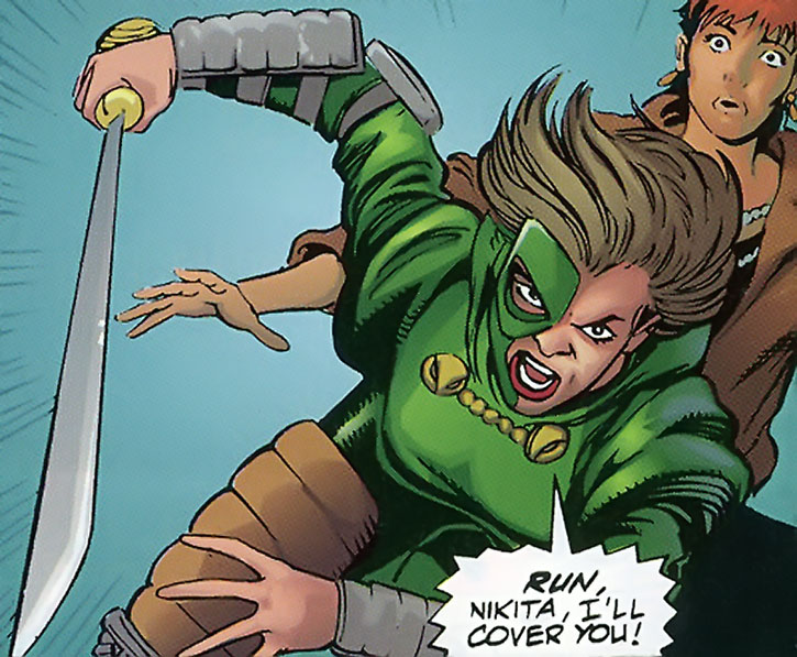 Jade Cobra, with her sword out, covers Nikita
