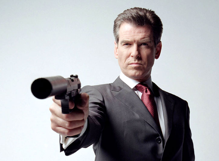 James Bond (Pierce Brosnan) points a suppressed pistol