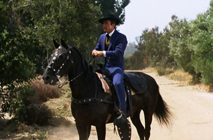 James West (Robert Conrad) on a black horse