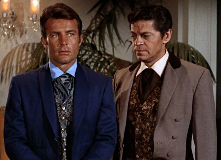 James West (Robert Conrad) and Artemus Gordon stand side by side