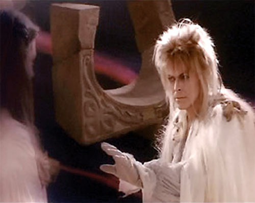 Jareth the Goblin King (David Bowie in Labyrinth) facing Sarah
