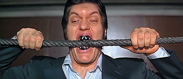 Jaws (Richard Kiel) biting through a steel cable