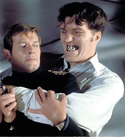Jaws (Richard Kiel in James Bond movies) grabs Roger Moore