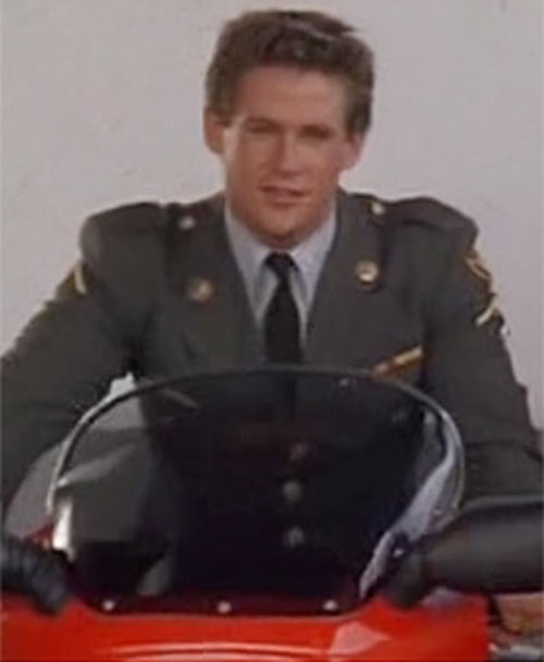 Joe Armstrong (Michael Dudikoff in American Ninja) in dress uniform on a motorbike
