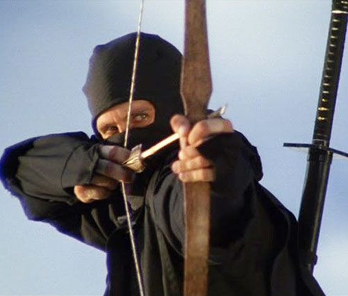 Joe Armstrong (Michael Dudikoff in American Ninja) aiming a bow