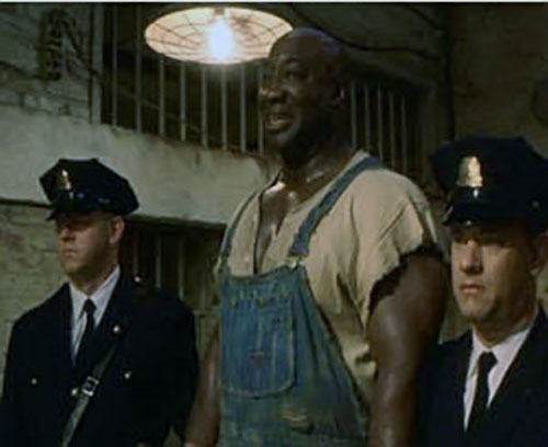 John Coffey (Michael Clarke Duncan in The Green Mile) (Stephen King) towering over two guards