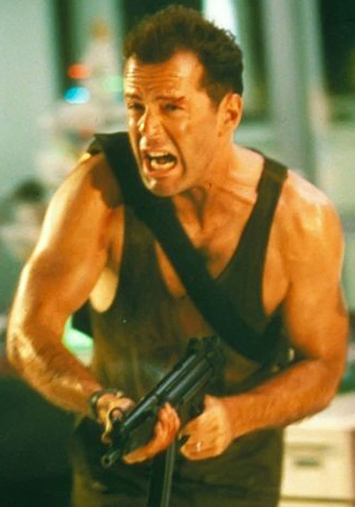 John McClane (Bruce Willis in Die Hard) with a submachinegun