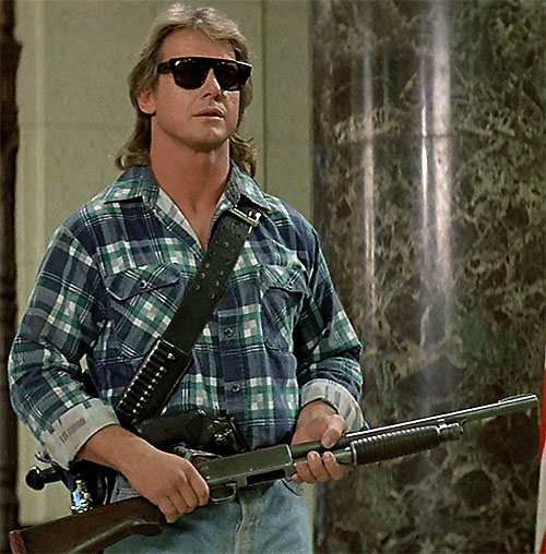 John Nada (Roddy Piper in They Live) with a shotgun