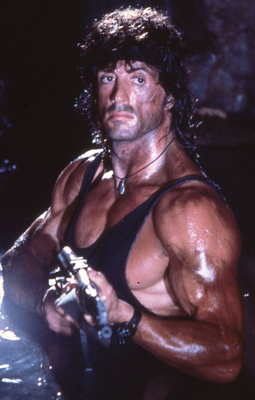 John Rambo (Sylvester Stallone) in the dark with an AK