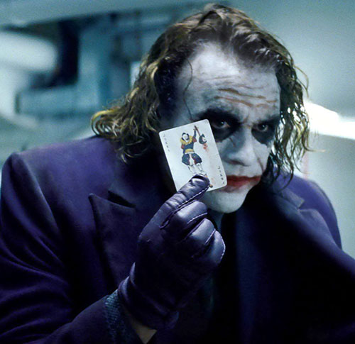 Joker (Heath ledger in the Batman Dark Knight movie) holding a joker card