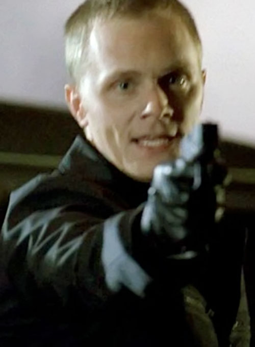 Julian Sark (David Anders in Alias) pointing a pistol