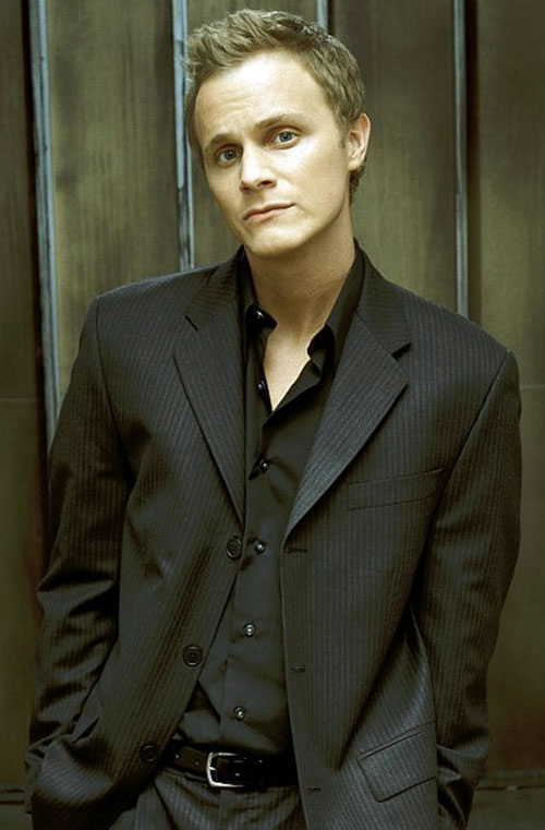 Julian Sark (David Anders in Alias) with a dark grey suit and shirt
