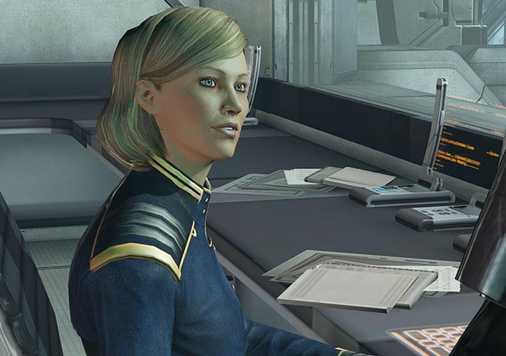 Kahlee Sanders sitting at her desk