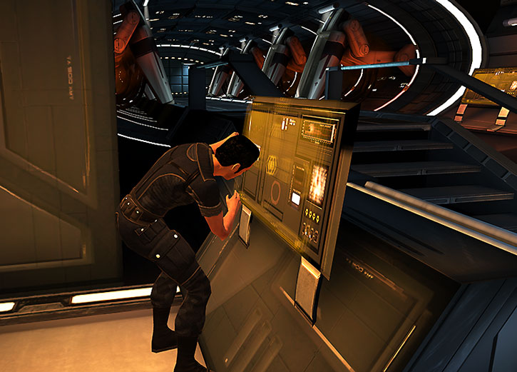 Kaidan Alenko tinkering with a computer console