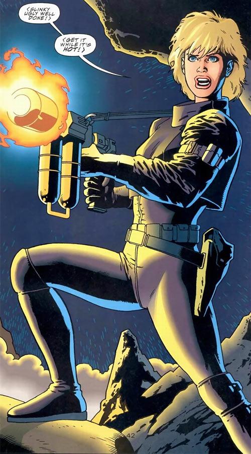 Kara (Superman vs. Aliens comics) with a flamethrower
