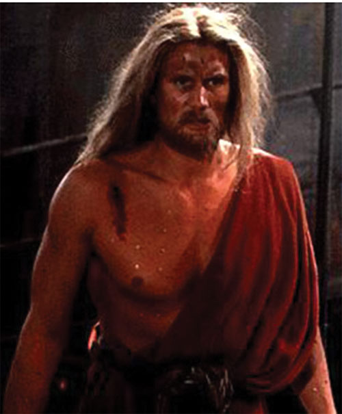 Karl Honig the street preacher (Dolph Lundgren in Johnny Mnemonic) in a toga