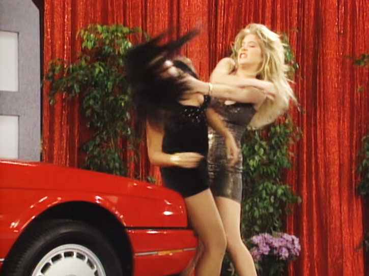 Kelly Bundy (Christina Applegate) in a catfight at a car expo