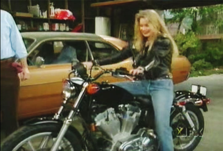Kelly Bundy (Christina Applegate) on a motorbike