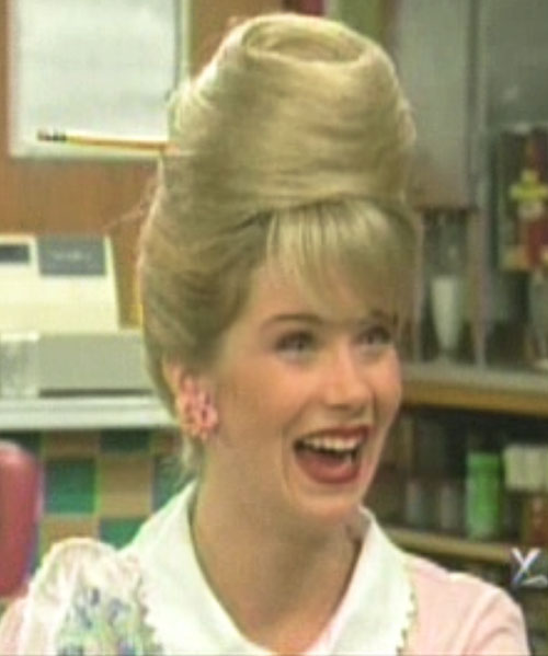 Kelly Bundy (Christina Applegate in Married With Children) with a conical haircut